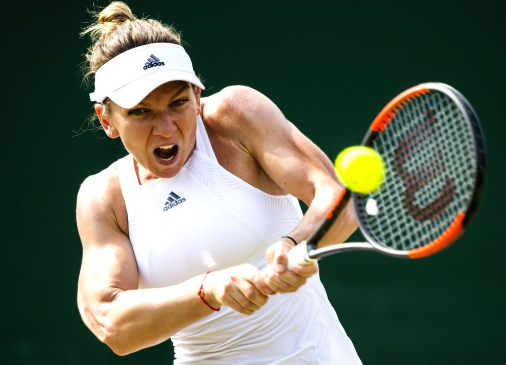 LONDON, July 8, 2017 - Simona Halep of Romania hits a return during the women's singles third round match against Peng Shuai of China at the Championship Wimbledon 2017 in London, Britain, on July 7, ...