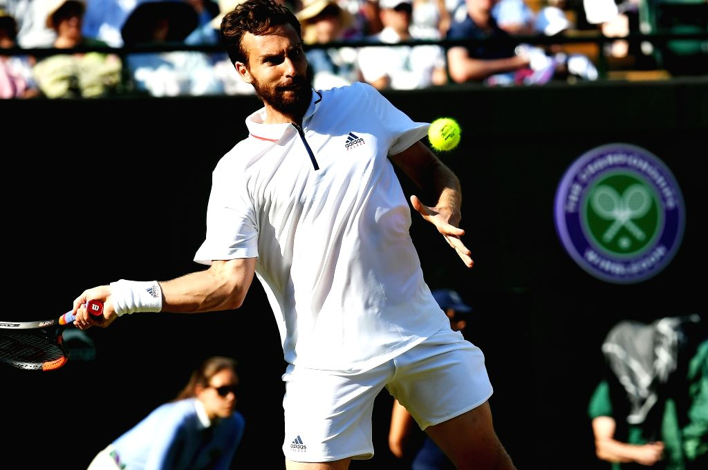 LONDON, July 8, 2018 - Ernests Gulbis of Latvia hits a return during the men's singles third round match against Alexander Zverev of Germany at the Wimbledon Championships 2018 in London, Germany, on ...