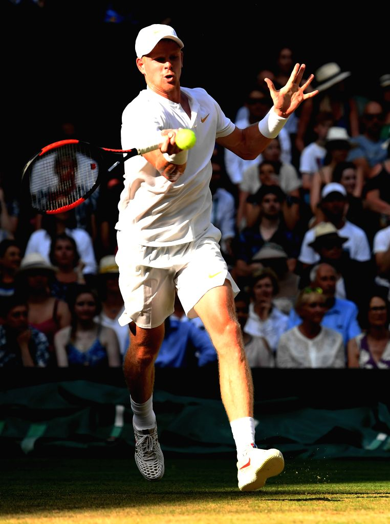 LONDON, July 8, 2018 - Kyle Edmund of Britain hits a return during the men's singles third round match against Novak Dokovic of Serbia at the Wimbledon Championships 2018 in London, Britain, on July ...