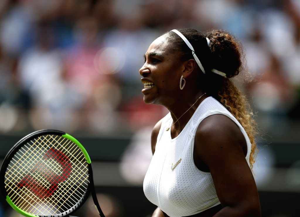 LONDON, July 8, 2019 (Xinhua) -- Serena Williams of the United States reacts during the women's singles fourth round match against Carla Suarez Navarro of Spain at the 2019 Wimbledon Tennis Championships in London, Britain, on July 8, 2019. (Xinhua/H