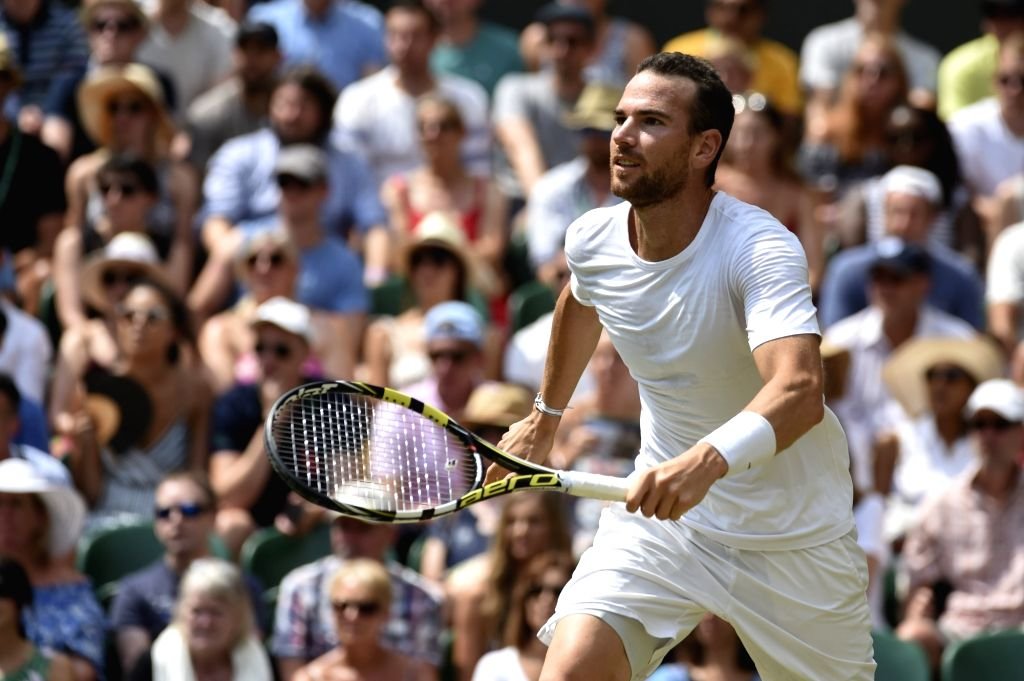 LONDON, July 9, 2018 - Adrian Mannarino of France competes during the men's singles fourth round match against Roger Federer of Switzerland at the Wimbledon Championships 2018 in London, Britain, on ...