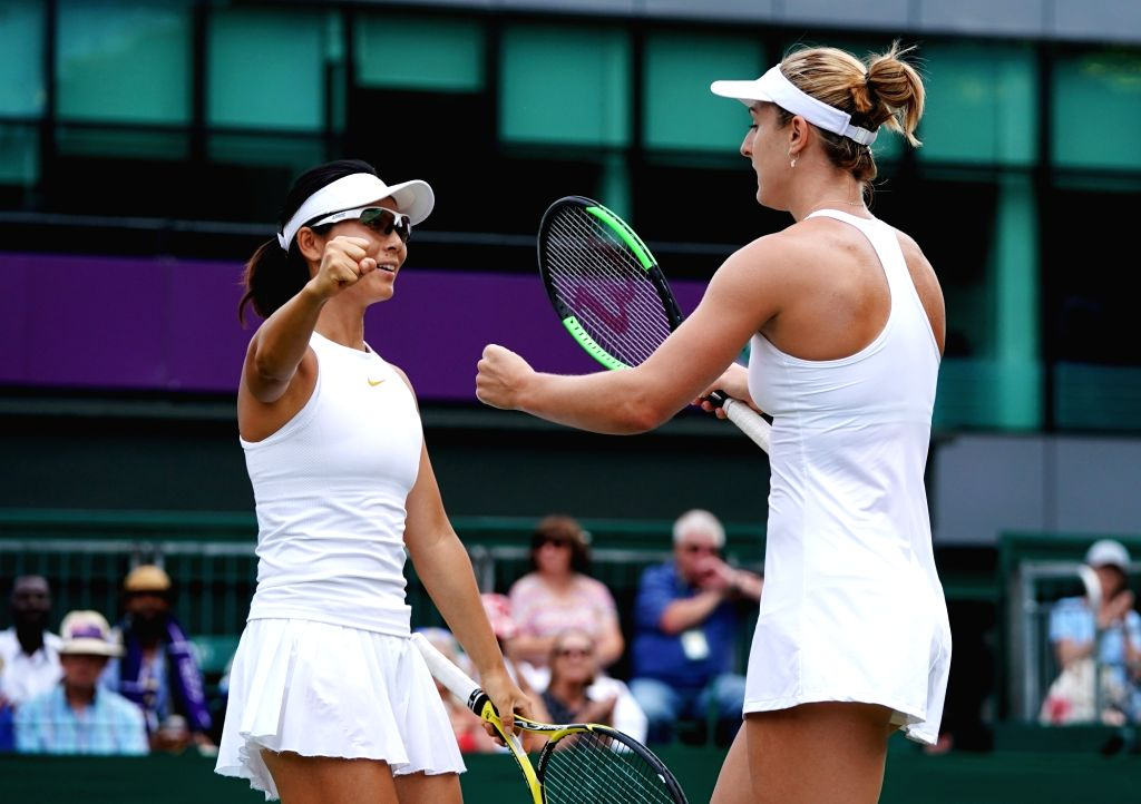 LONDON, July 9, 2018 - Xu Yifan (L) of China and Gabriela Dabrowski of Canada celebrate during the women's doubles third round match against Katarina Srebotnik of Slovenia and Vania King of the ...