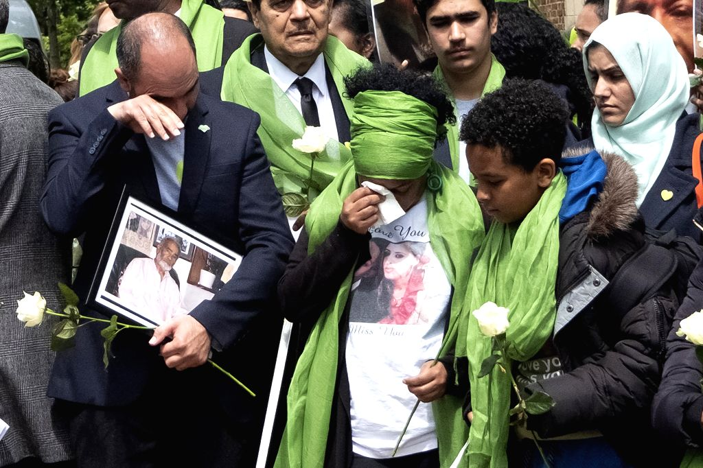 LONDON, June 14, 2019 - People attend a commemoration marking the second anniversary of the Grenfell Tower fire in London, Britain, on June 14, 2019. The deadly fire in the Grenfell Tower caused 72 ...