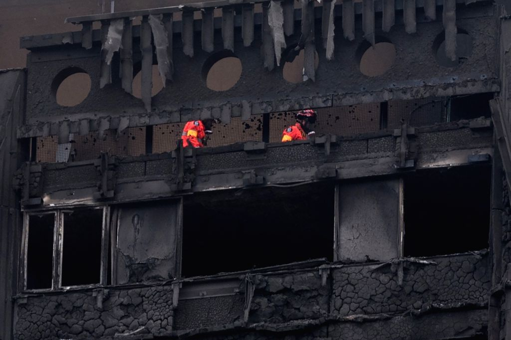 LONDON, June 16, 2017 - Fire safety specialists inspect the top floor of Grenfell Tower in London, Britain, on June 16, 2017. London's Metropolitan Police confirmed Friday that at least 30 people ...