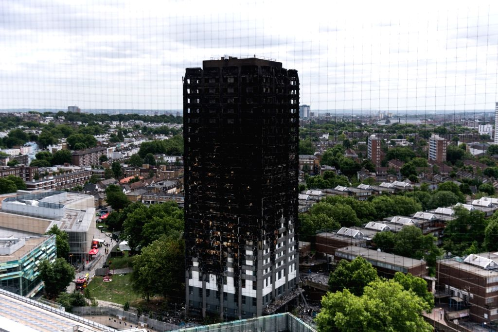 LONDON, June 16, 2017 - Photo taken on June 16, 2017 shows a view of Grenfell Tower after the fire in London, Britain. London's Metropolitan Police confirmed Friday that at least 30 people died in ...
