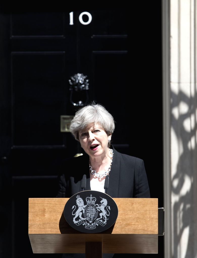 LONDON, June 19, 2017 - British Prime Minister Theresa May gives a statement outside 10 Downing Street following the Finsbury Park mosque attack in London, Britain on June 19, 2017. At least one was ... - Theresa May