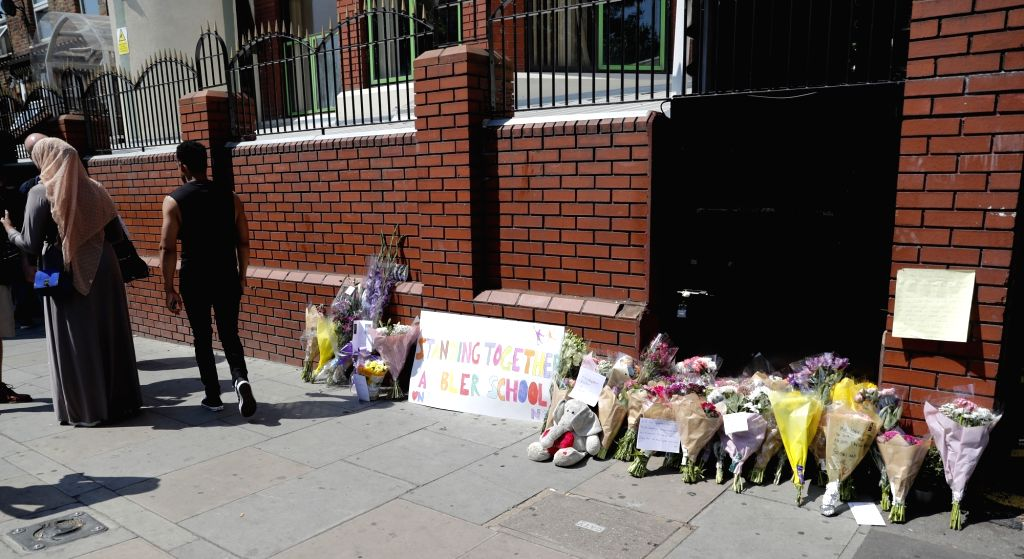 LONDON, June 19, 2017 - People leave flowers and cards outside Finsbury Park mosque near the scene of an attack in Finsbury Park in the early hours of this morning in London, Britain on June 19, ...