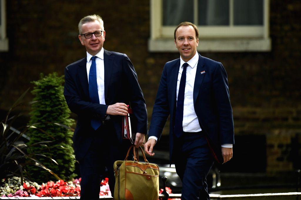 LONDON, June 19, 2019 - British Environment Secretary Michael Gove (L) and Health Secretary Matt Hancock arrive at 10 Downing Street to attend Cabinet meeting, in London, Britain, on June 18, 2019.