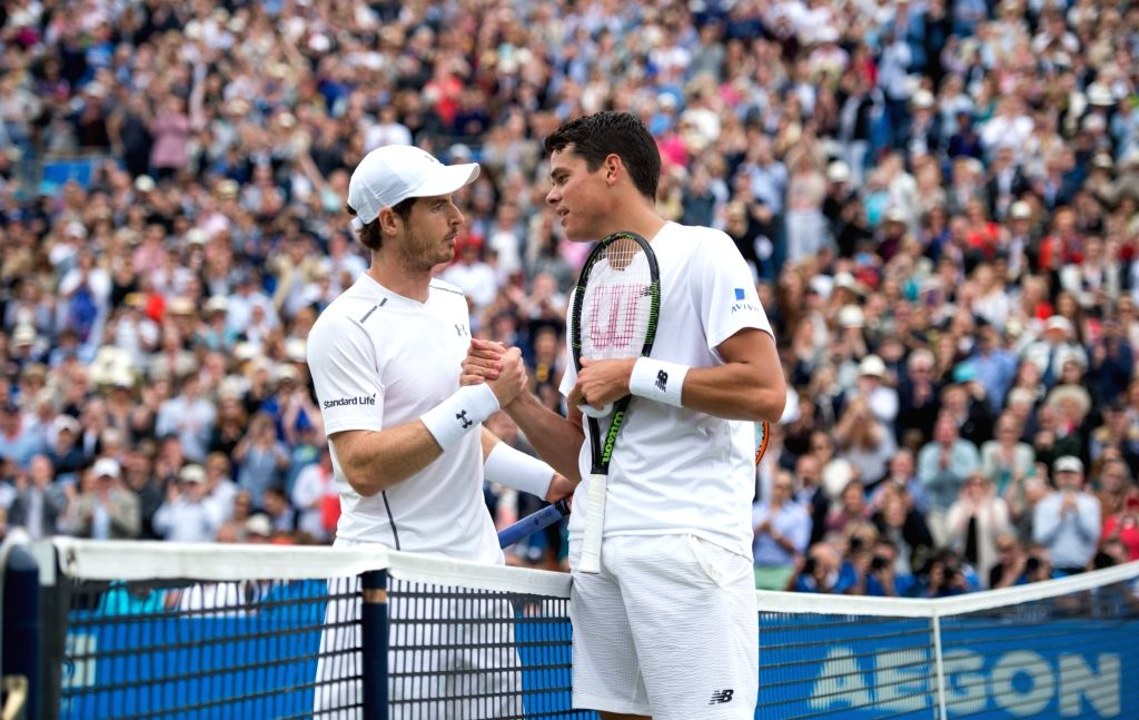 LONDON, June 20, 2016 - Andy Murray (L) of Britain shakes hands with Milos Raonic of Canada after their men's singles final on day seven of the ATP-500 Aegon Championships at the Queen's Club in ...