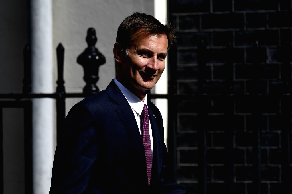 LONDON, June 20, 2019 (Xinhua) -- File photo taken on June 18, 2019 shows British Foreign Secretary Jeremy Hunt arriving at 10 Downing Street to attend a cabinet meeting in London, Britain. Former Foreign Secretary Boris Johnson and his successor as