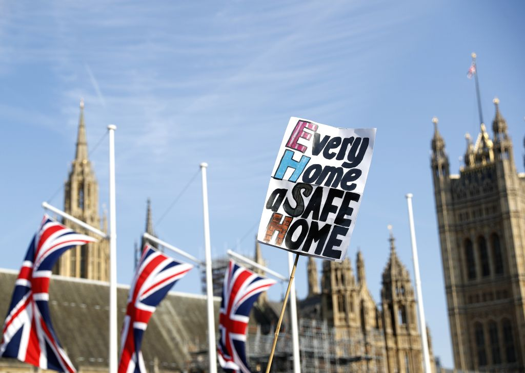 LONDON, June 22, 2017 - People hold a placard calling for justice for victims in the Grenfell tower fire during an anti-government protest at the Parliament Square in London, Britain on June 21, 2017.