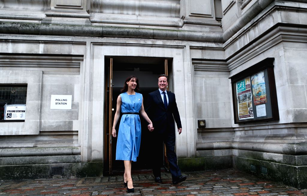 LONDON, June 23, 2016 - Britain's Prime Minister, David Cameron and his wife Samantha leave the Central Methodist Hall polling station after casting their votes for the EU Referendum in London, on ...
