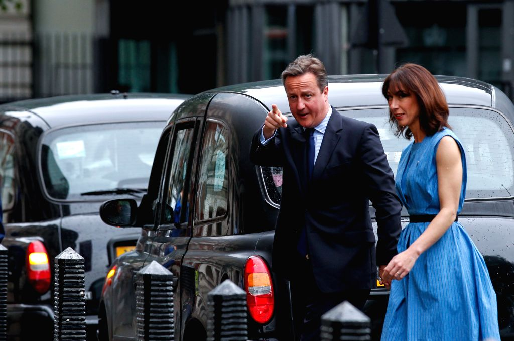 LONDON, June 23, 2016 - Britain's Prime Minister, David Cameron and his wife Samantha arrive at the Central Methodist Hall polling station to cast their votes for the EU Referendum in London, on June ...