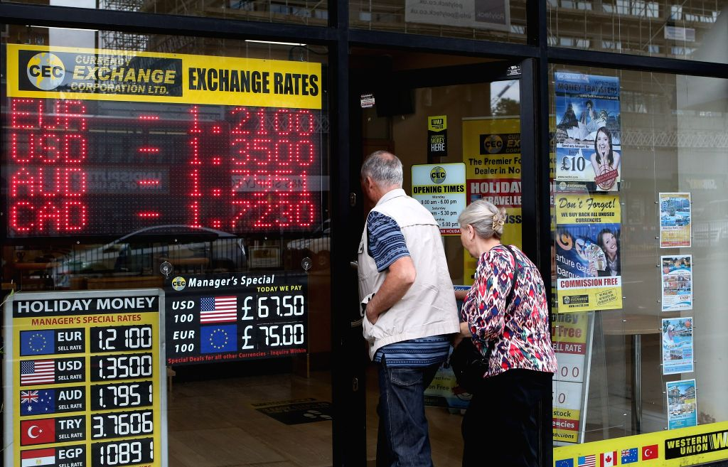 LONDON, June 24, 2016 - Customers enter a currency exchange shop in London, Britain, on June 24, 2016.