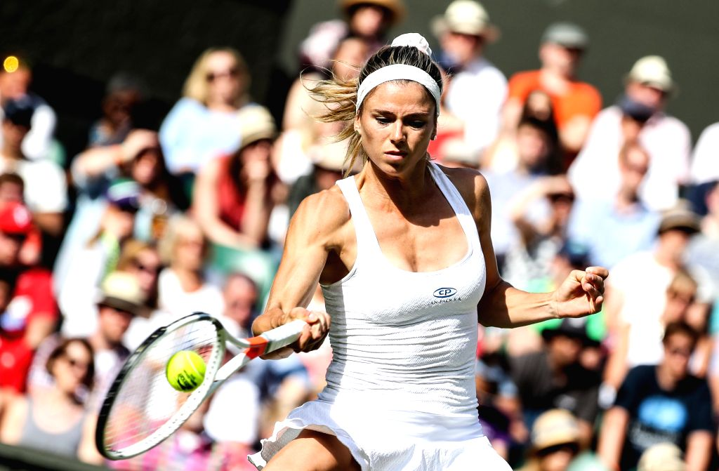 LONDON, June 28, 2016 - Camila Giorgi of Italy returns the ball during the women's singles first round match against Garbine Muguruza of Spain at the 2016 Wimbledon Tennis Championships in London, ...