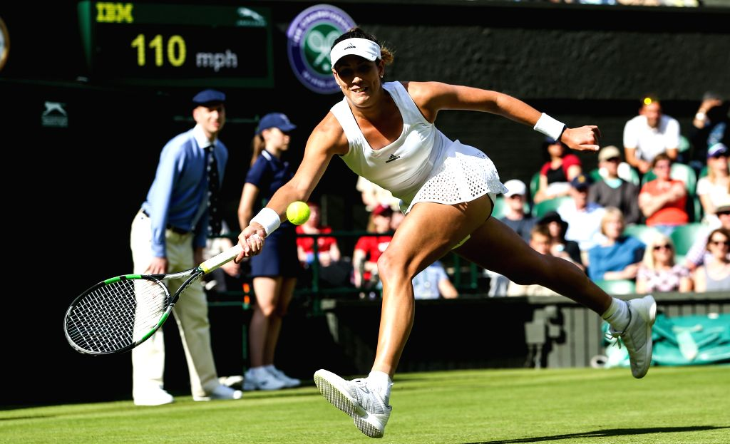 LONDON, June 28, 2016 - Garbine Muguruza of Spain returns the ball during the women's singles first round match against Camila Giorgi of Italy at the 2016 Wimbledon Tennis Championships in London, ...