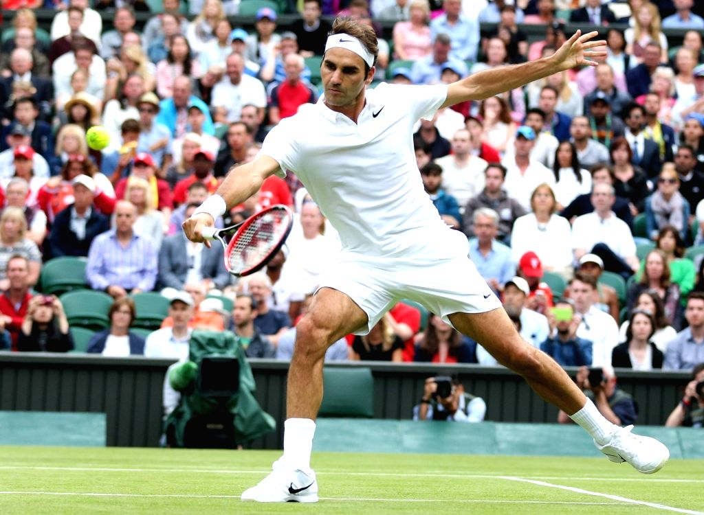 LONDON, June 28, 2016 - Roger Federer of Switzerland returns the ball during the men's singles first round match against Guido Pella of Argentina at the 2016 Wimbledon Tennis Championships in London, ...