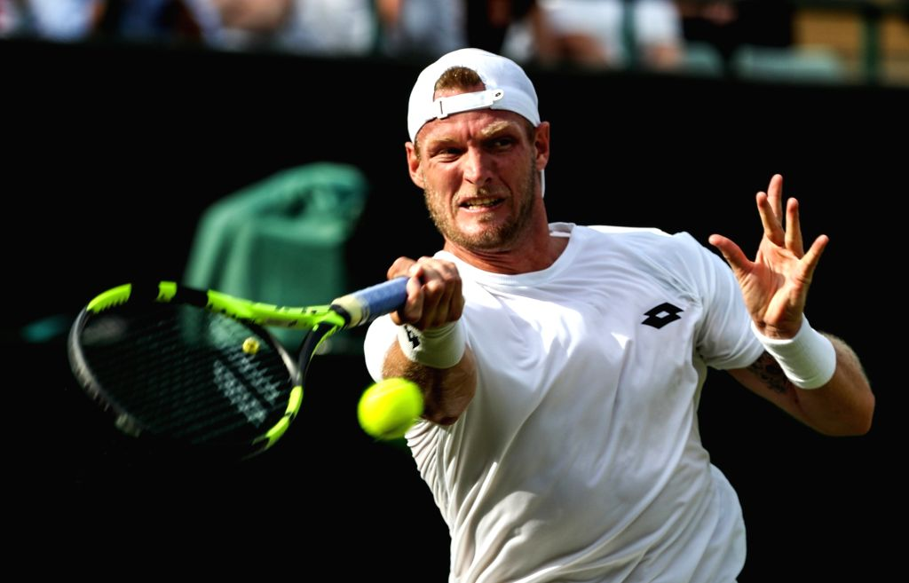 LONDON, June 28, 2016 - Sam Groth of Australia returns the ball during the men's singles first round match against Kei Nishikori of Japan at the 2016 Wimbledon Tennis Championships in London, June ...