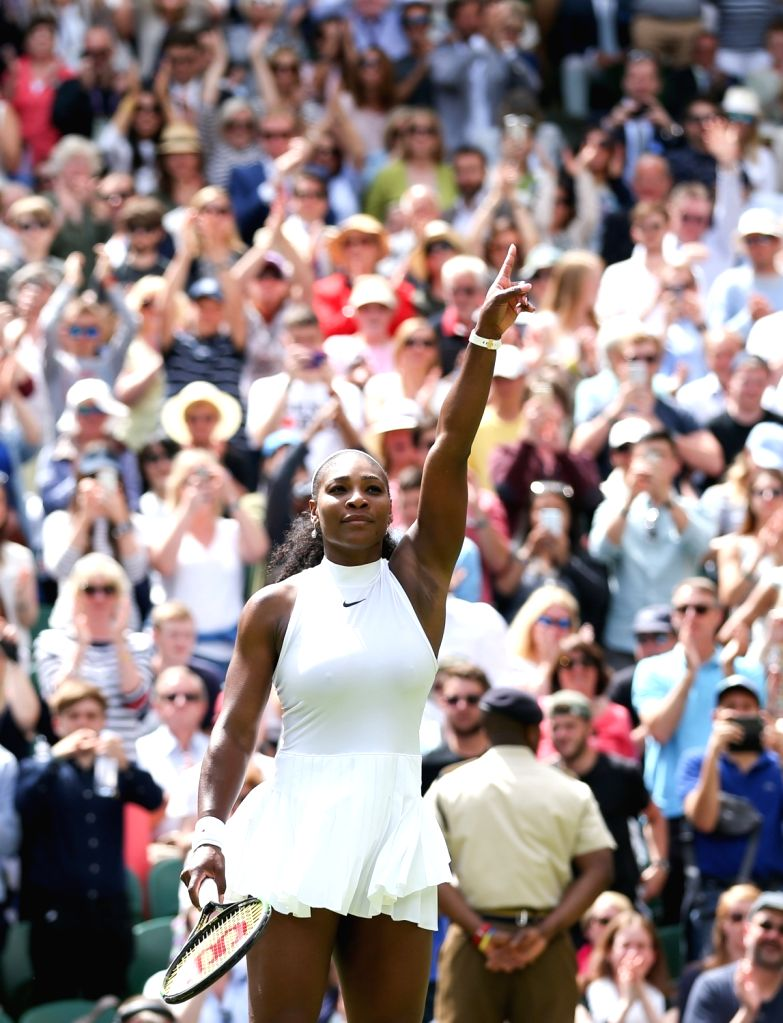 LONDON, June 28, 2016 - Serena Williams of the United States celebrates after winning a women's singles first round match with Amra Sadikovic of Switzerland on Day 2 at the 2016 Wimbledon Tennis ...