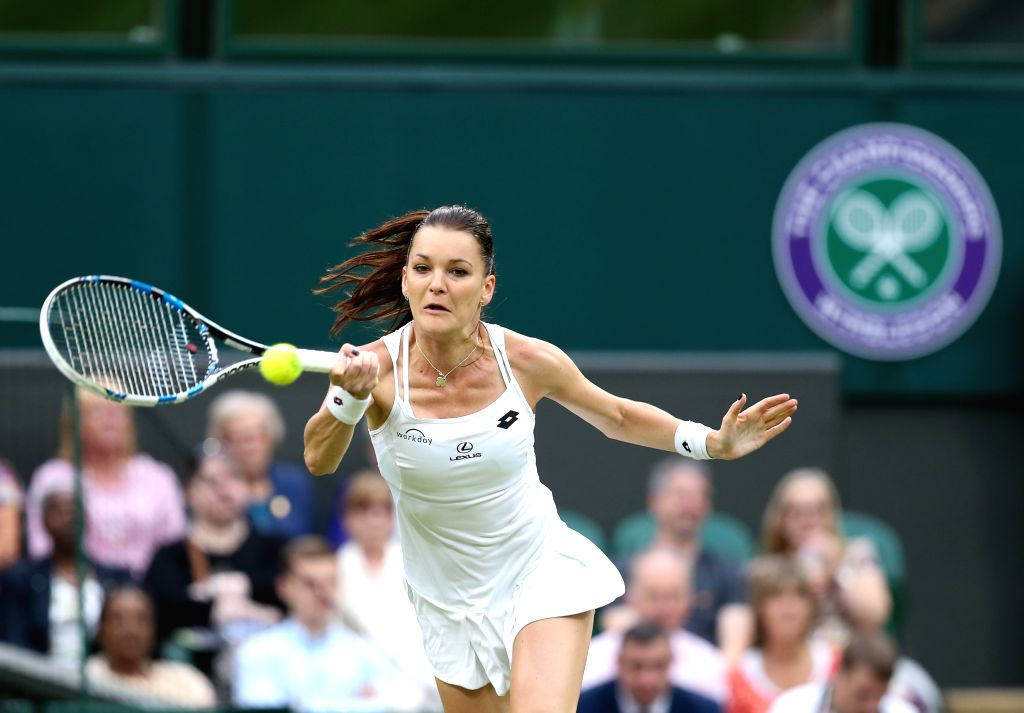 LONDON, June 29, 2016 - Agnieszka Radwanska of Poland hits the ball during the women's singles first round match against Kateryna Kozlova of Ukraine on Day 3 at The Championships Wimbledon 2016 in ...