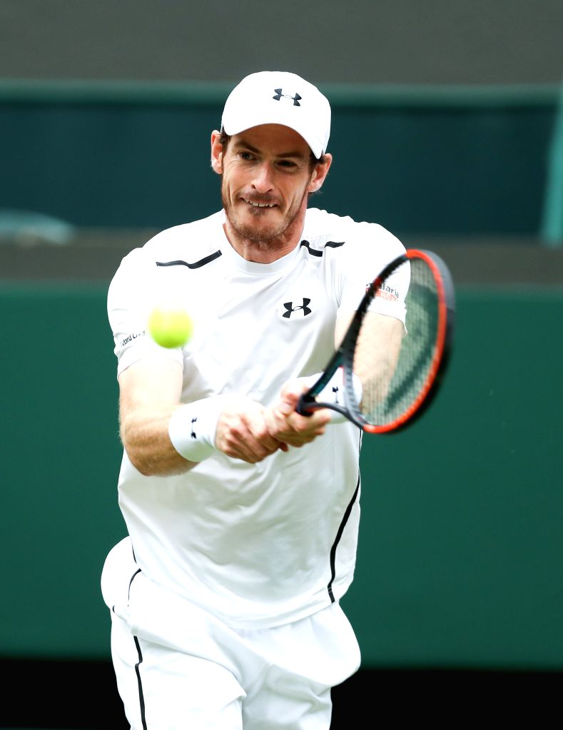 LONDON, June 29, 2016 - Andy Murray of Britain returns the ball during the men's singles first round match against his compatriot Liam Broady on Day 2 of the 2016 Wimbledon Tennis Championships in ...