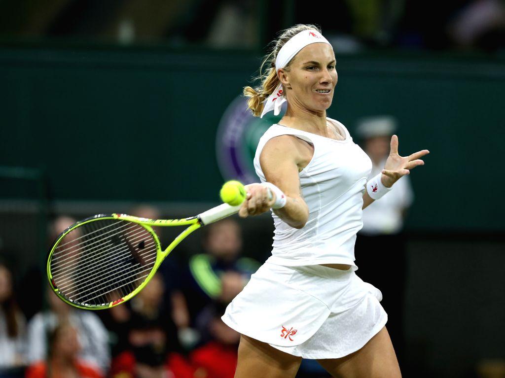 LONDON, June 29, 2016 - Svetlana Kuznetsova of Russia returns the ball during the women's singles first round match against Caroline Wozniacki of Denmark on Day 2 of the 2016 Wimbledon Tennis ...