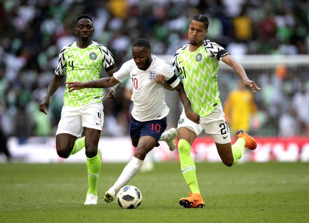 LONDON, June 3, 2018 - Raheem Sterling (C) of England vies with Nigeria's Tyronne Ebuehi (R) and Kenneth Omeruo during the International Friendly Football match at Wembley Stadium in London, Britain ...