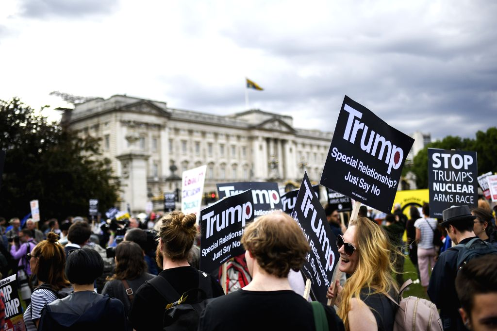 LONDON, June 3, 2019 - Demonstrators gather outside Buckingham Palace to protest against U.S. President Donald Trump in London, Britain, on June 3, 2019. U.S. President Donald Trump was greeted with ...
