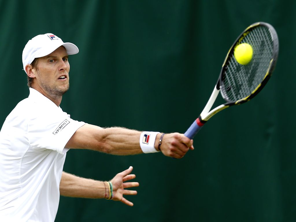 LONDON, June 30, 2016 - Andreas Seppi of Italy returns the ball to Milos Raonic of Canada during the men's singles second round match at the 2016 Wimbledon Championships in Wimbledon, southwest ...