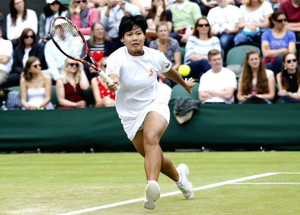 LONDON, June 30, 2016 - Lersak Kumkhum of Thailand returns a ball to Timea Bacsinszky of Switzerland during a women's singles first round match at the 2016 Wimbledon Championships in Wimbledon, ...