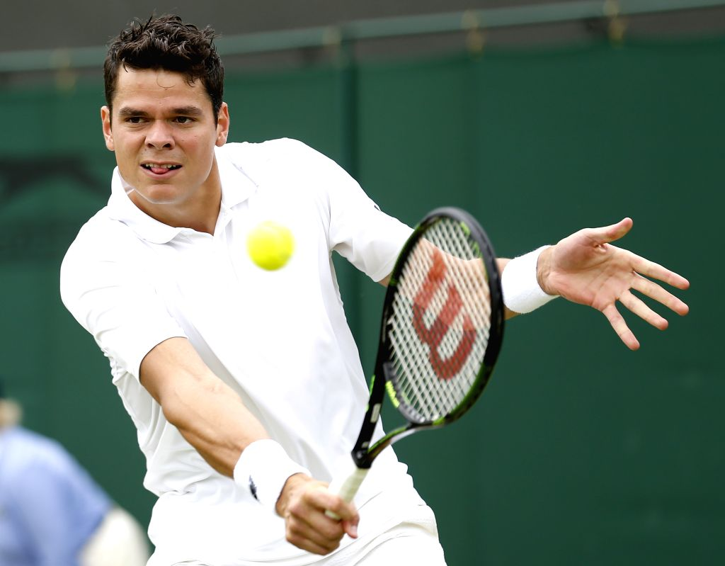 LONDON, June 30, 2016 - Milos Raonic of Canada returns the ball to Andreas Seppi of Italy during the men's singles second round match at the 2016 Wimbledon Championships in Wimbledon, southwest ...