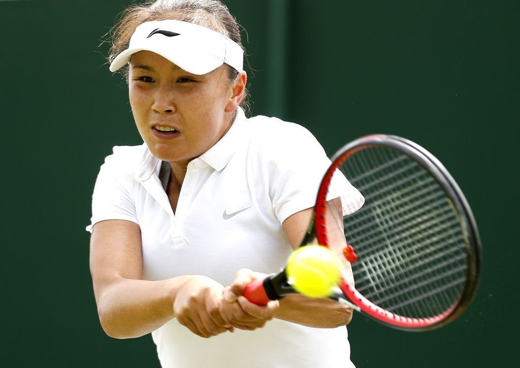 LONDON, June 30, 2016 - Peng Shuai of China returns a ball to Sloane Stephens of the United States during a women's single first round match at the 2016 Wimbledon Championships in Wimbledon, ...
