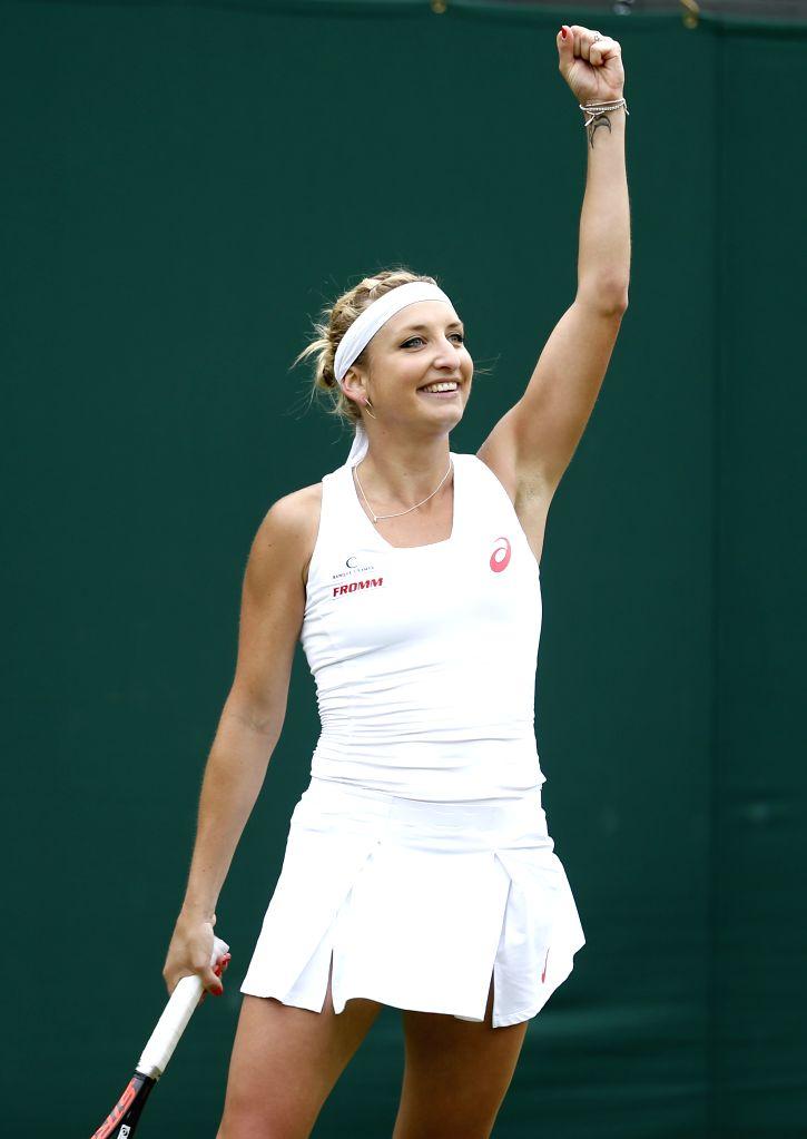 LONDON, June 30, 2016 - Timea Bacsinszky of Switzerland celebrates after winning a women's singles first round match against Lersak Kumkhum of Thailand at the 2016 Wimbledon Championships in ...