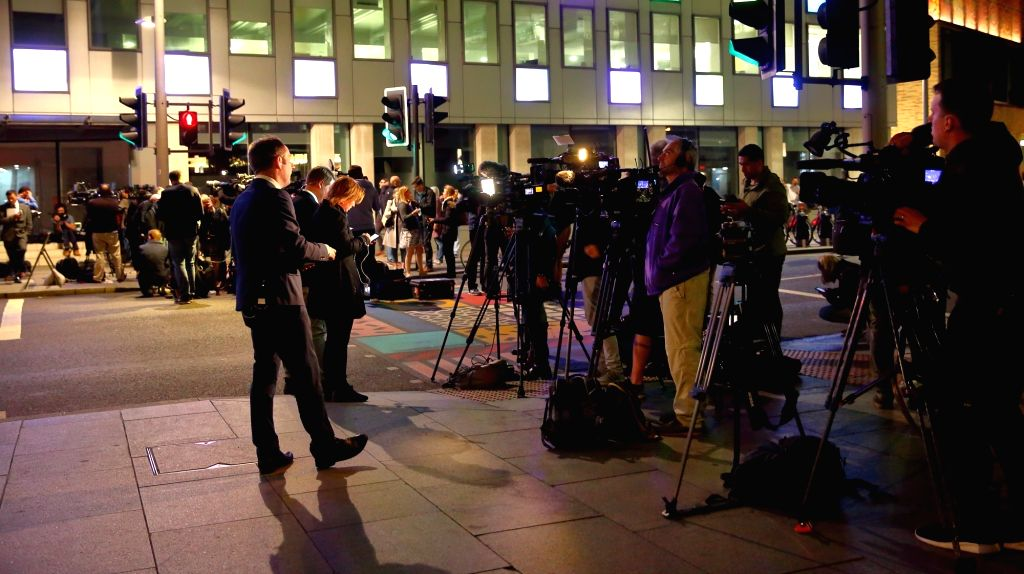 LONDON, June 4, 2017 - Journalists report near the London Bridge in London, Britain, on June 3, 2017. Unidentified attackers drove a van into pedestrians on London Bridge Saturday night and stabbed ...