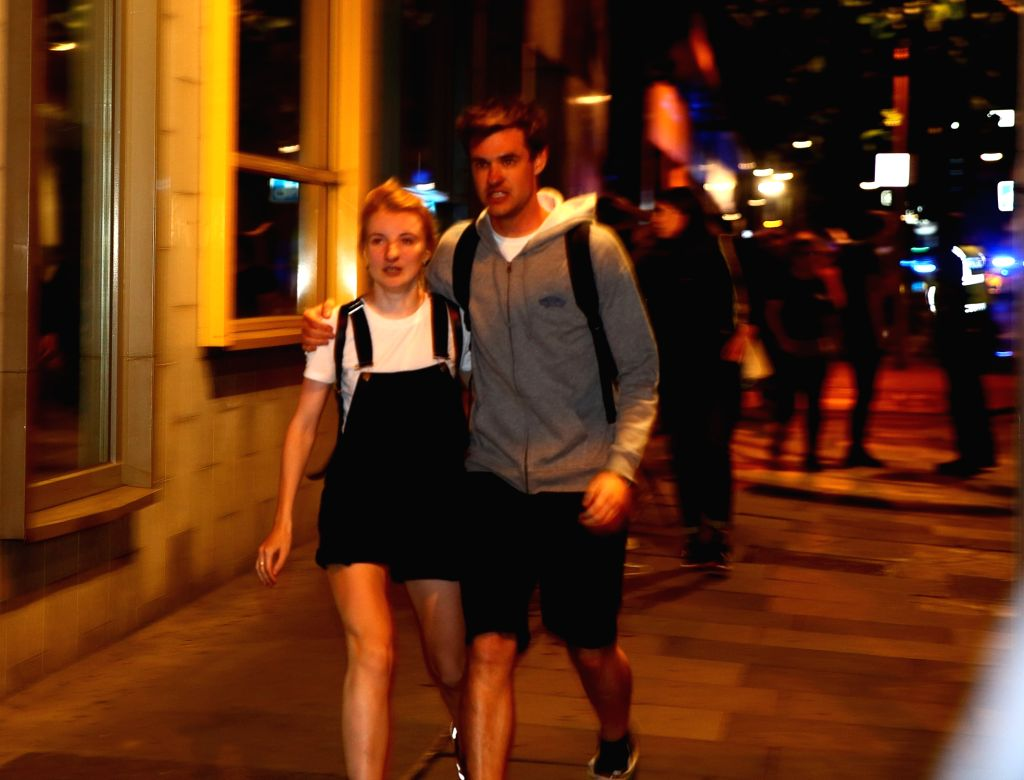 LONDON, June 4, 2017 - People evacuate near the London Bridge in London, Britain, on June 3, 2017. Unidentified attackers drove a van into pedestrians on London Bridge Saturday night and stabbed ...