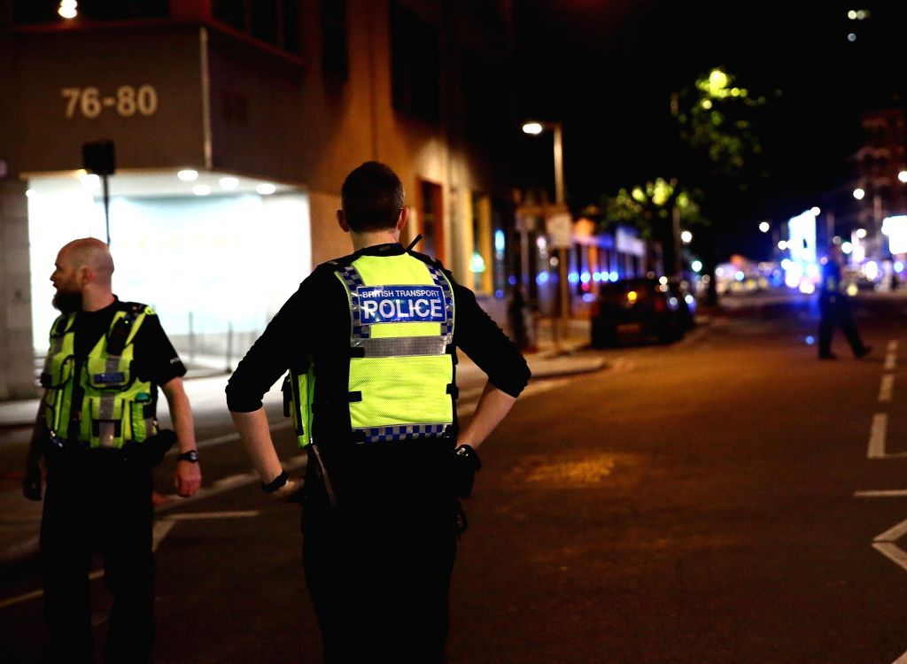 LONDON, June 4, 2017 - Police stand guard near the London Bridge in London, Britain, on June 3, 2017. Unidentified attackers drove a van into pedestrians on London Bridge Saturday night and stabbed ...