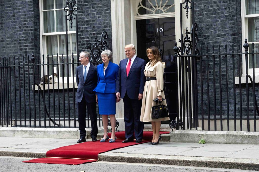 LONDON, June 4, 2019 - U.S. President Donald Trump (2nd R) and First Lady Melania Trump (1st R) pose for photos with British Prime Minister Theresa May (2nd L) and her husband Philip May (1st L) at ... - Theresa May