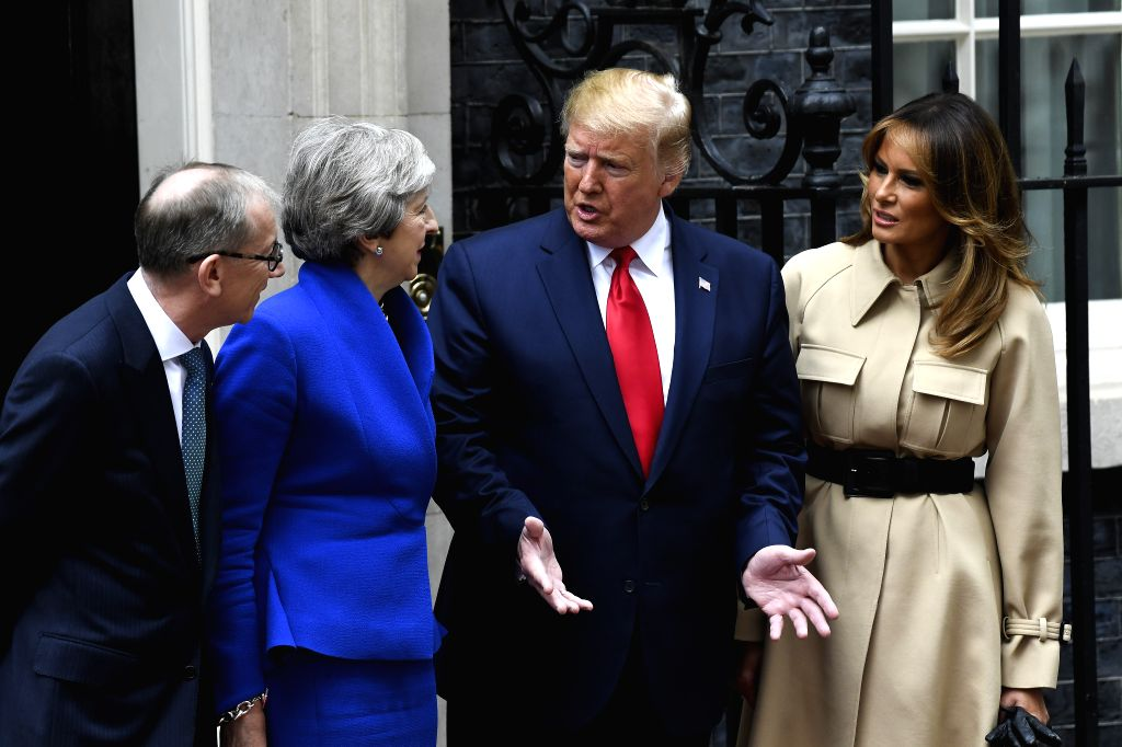 LONDON, June 4, 2019 - U.S. President Donald Trump (2nd R) and his wife Melania Trump (1st R) pose for photos with British Prime Minister Theresa May (2nd L) and her husband Philip May at 10 Downing ... - Theresa May