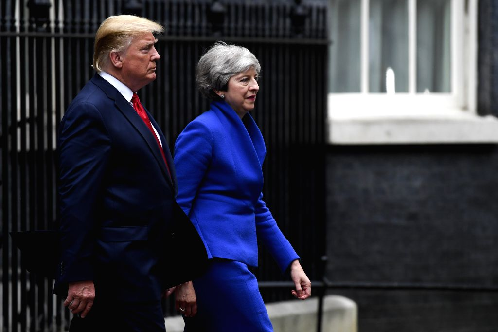 LONDON, June 4, 2019 - U.S. President Donald Trump (L) and British Prime Minister Theresa May leave 10 Downing Street in London, Britain, on June 4, 2019. British Prime Minister Theresa May said ... - Theresa May