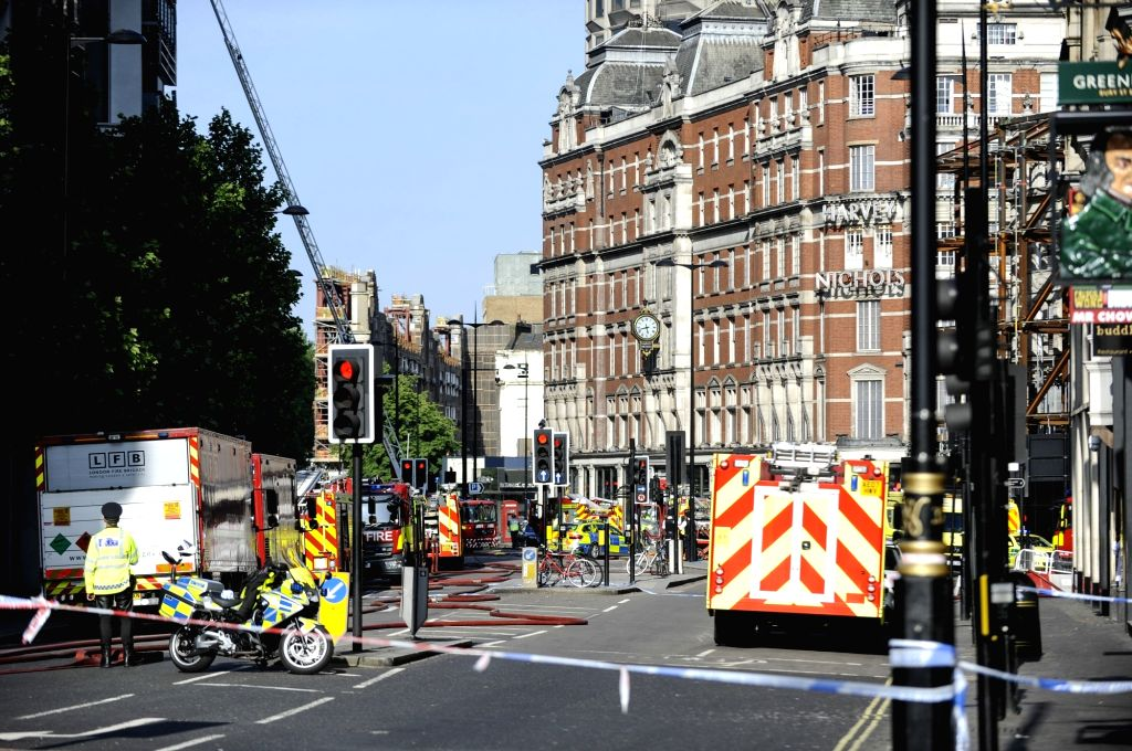 LONDON, June 6, 2018 - Firefighters and emergency services staff work at the scene after a fire broke out at Mandarin Oriental Hotel in London's Knightsbridge, Britain, on June 6, 2018. A total of 20 ...