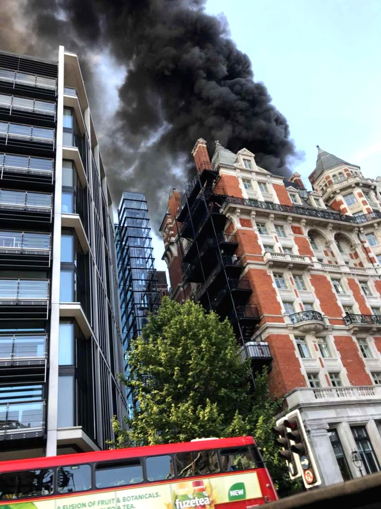 LONDON, June 6, 2018 - Photo taken on June 6, 2018 shows a massive blaze engulfs Mandarin Oriental Hotel in London's Knightsbridge, Britain. 15 fire engines and nearly 100 firefighters rushed to ...