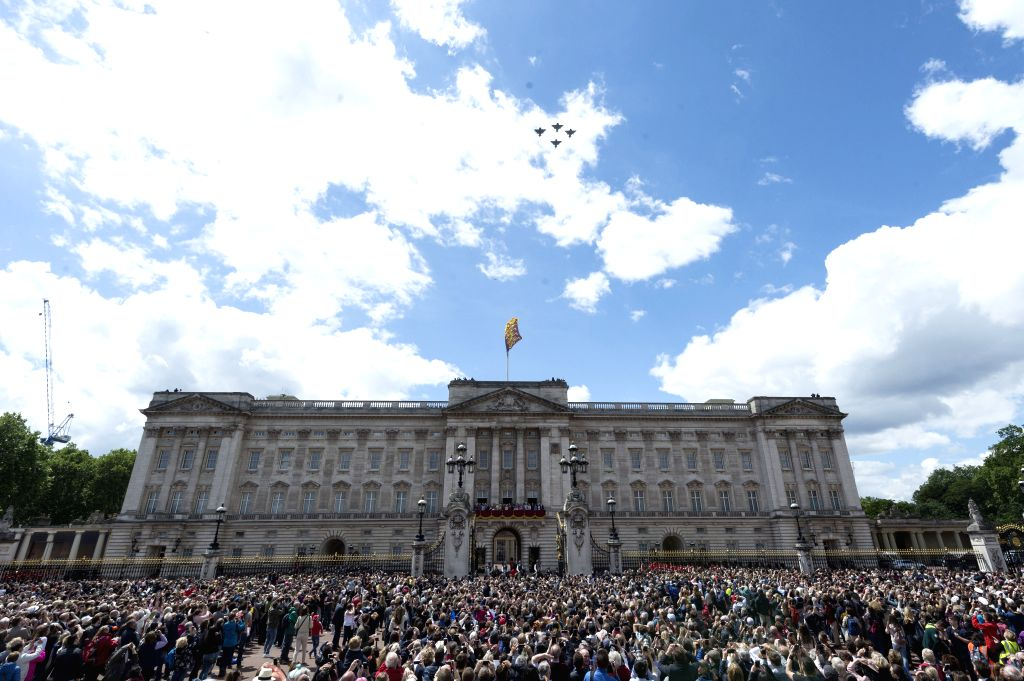 LONDON, June 8, 2019 (Xinhua) -- People gather in front of Buckingham Palace during the Trooping the Colour ceremony to mark Queen Elizabeth II's 93rd birthday in London, Britain, on June 8, 2019. Queen Elizabeth celebrated her official 93rd birthday