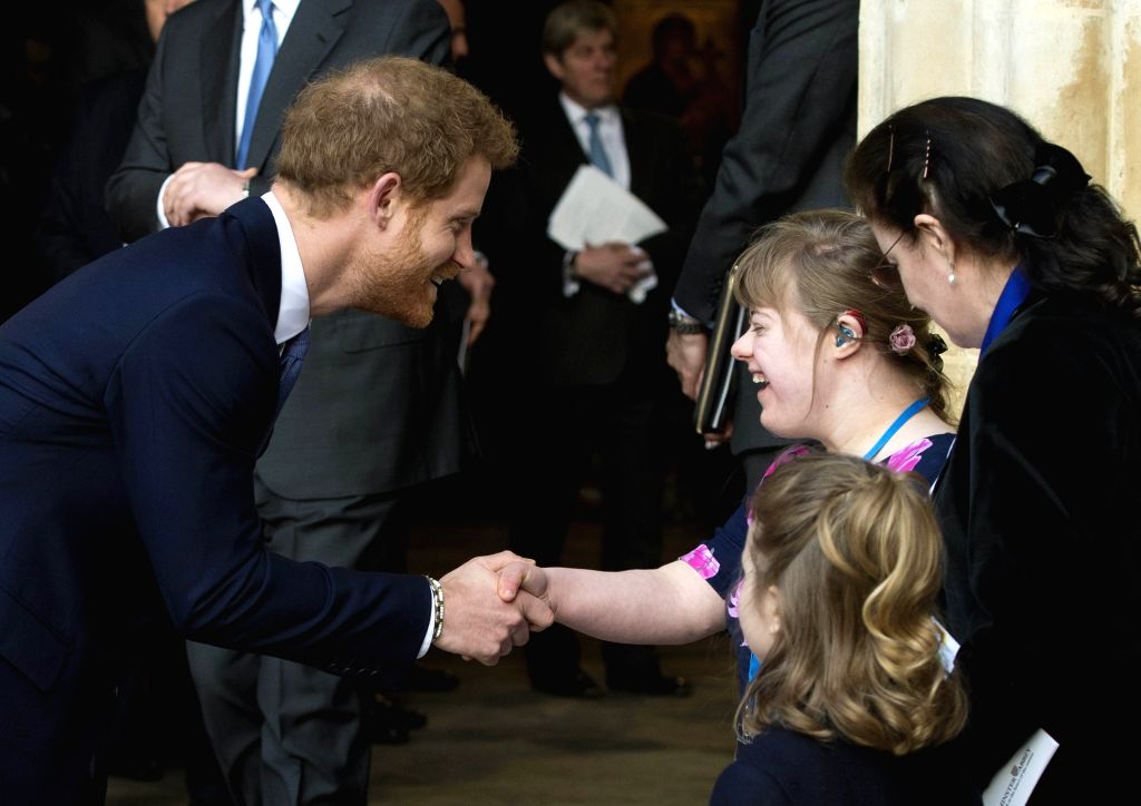 LONDON, March 13, 2017 - Prince Harry (L, Front) shakes hands with one of the flower girls after attending the Commonwealth Day celebrations service at Westminster Abbey in London, Britain, on March ...