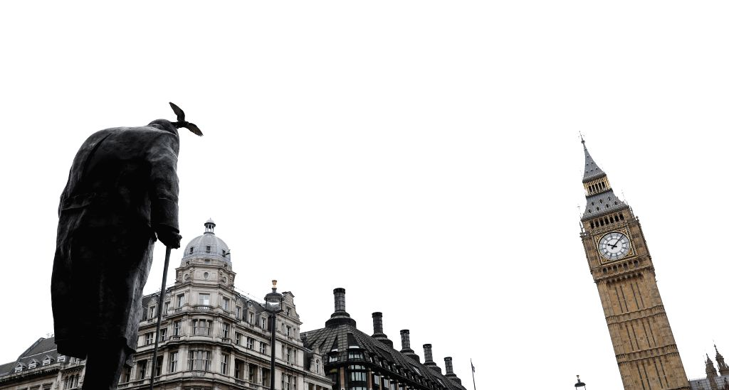 """LONDON, March 14, 2017 - Photo taken on March 14, 2017 shows the statue of Winston Churchill and the """"Big Ben"""" in central London, Britain. The British upper house of the Parliament passed ..."""