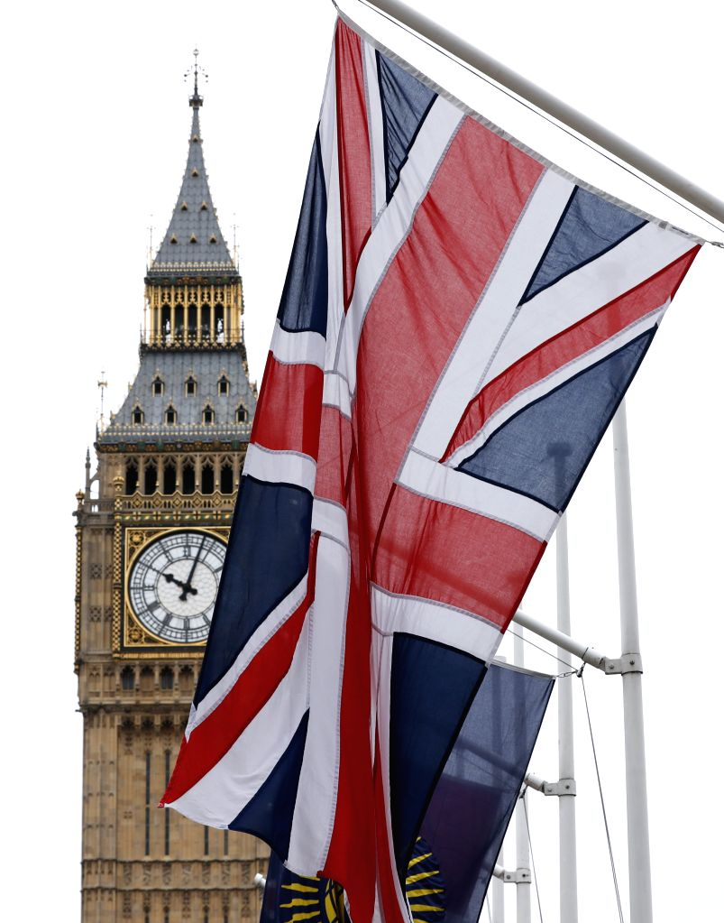 """LONDON, March 14, 2017 - Photo taken on March 14, 2017 shows the """"Big Ben"""" and the UK flag in central London, Britain. The British upper house of the Parliament passed the Brexit Bill ..."""