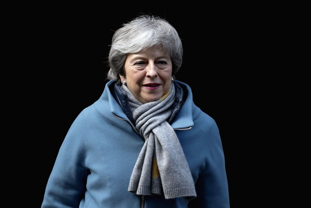 LONDON, March 14, 2019 - British Prime Minister Theresa May leaves 10 Downing Street for the House of Commons in London, Britain, on March 14, 2019. British MPs on Thursday voted overwhelmingly to ... - Theresa May