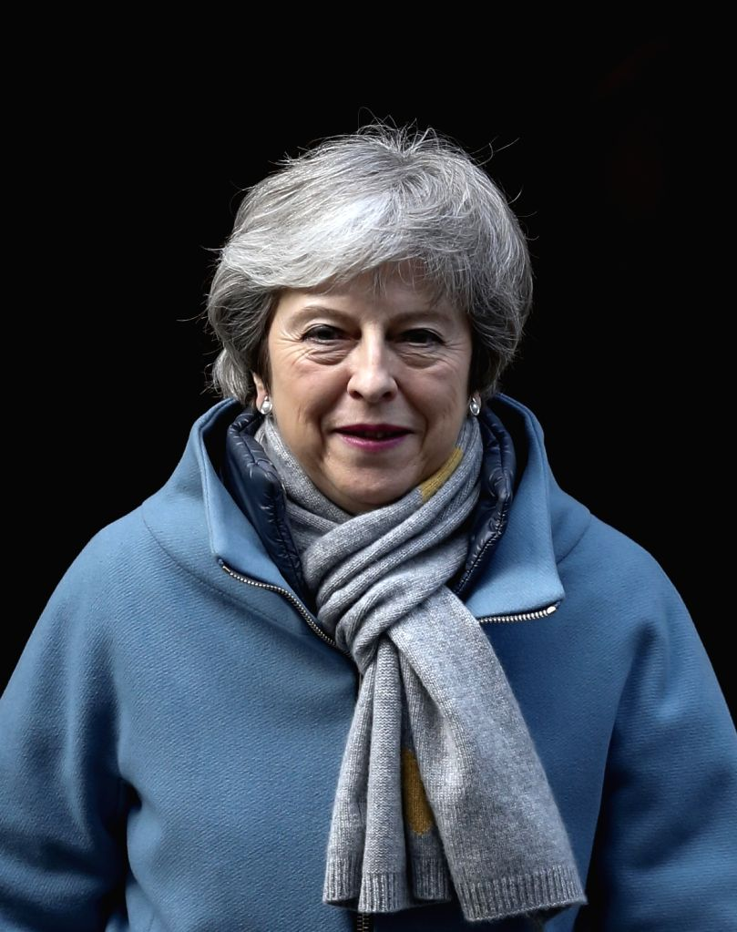 LONDON, March 14, 2019 - British Prime Minister Theresa May leaves 10 Downing Street for the House of Commons in London, Britain, on March 14, 2019. British MPs on Thursday voted to reject an ... - Theresa May