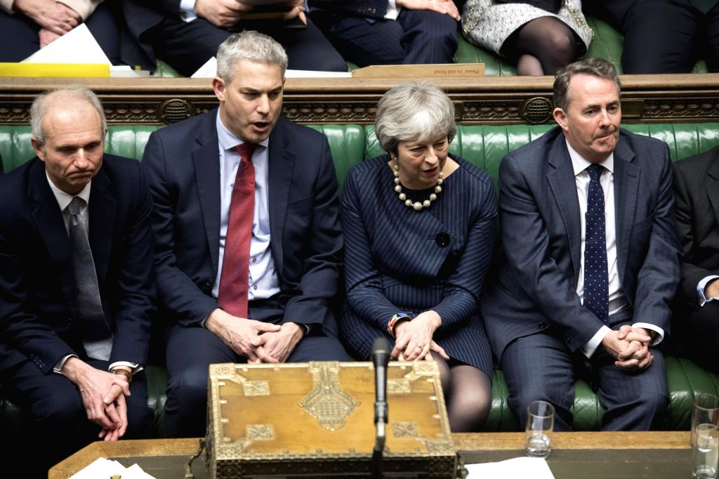 LONDON, March 14, 2019 - British Prime Minister Theresa May (2nd R) is seen during a vote in the House of Commons in London, Britain on March 14, 2019. British MPs on Thursday voted overwhelmingly to ... - Theresa May