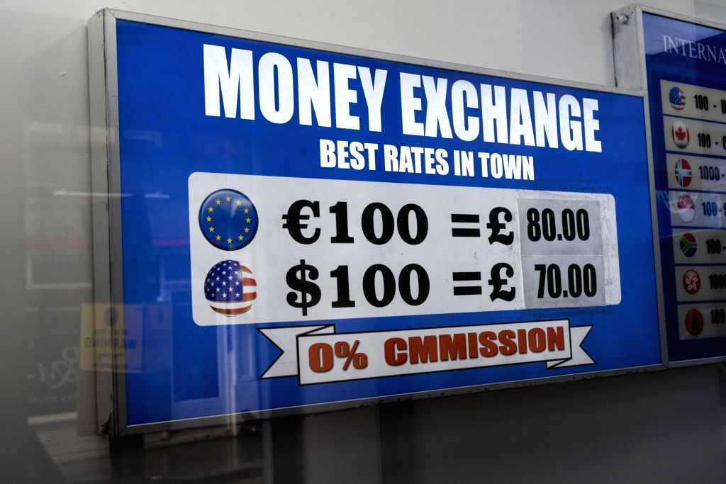 LONDON, March 14, 2019 - The photo taken on March 14, 2019 shows the currency rates displayed in a money exchange in London, Britain. British MPs on Thursday voted overwhelmingly to ask the European ...