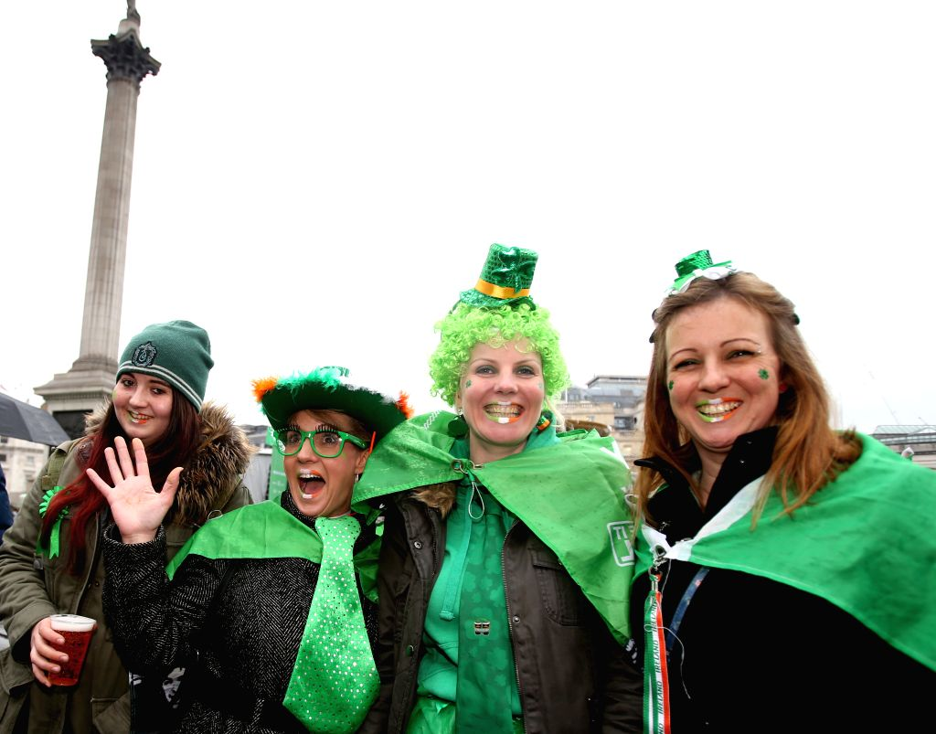Colorfully dressed people participate in the celebration of St. Patrick's Day in Trafalgar Square in central London, Britain, on  March 15, 2015. The celebration of ...